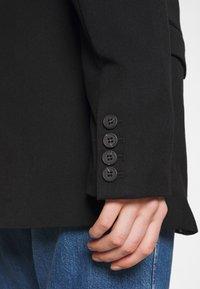 Monki - BLUSH SCALE UP - Short coat - black dark - 5