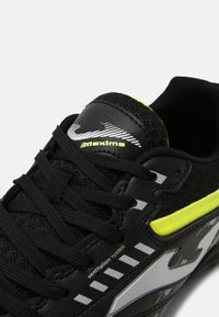 Joma - MAXIMA - Astro turf trainers - black/yellow - 6
