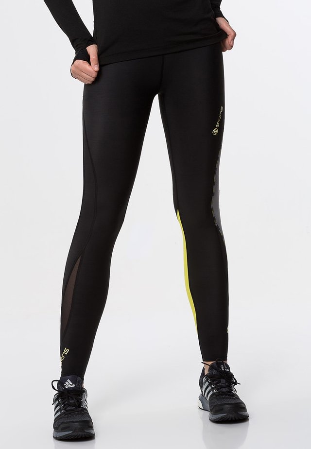 DNAMIC - Leggings - black/limoncello