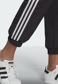 adidas Originals - Tracksuit bottoms - black - 2