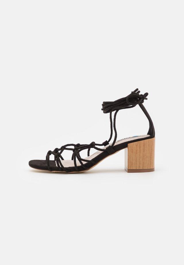 MEGRIS - Sandaalit nilkkaremmillä - black