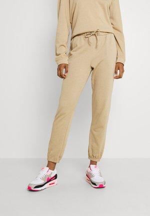 VIRUST  - Teplákové kalhoty - beige