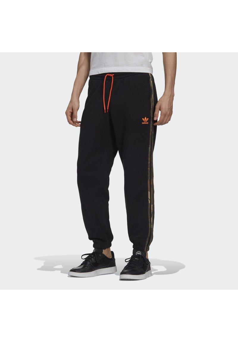 adidas Originals - CAMO JOGGERS - Tracksuit bottoms - black