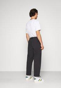 adidas Originals - TRIAL PANT - Tygbyxor - black - 2