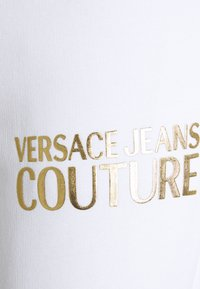 Versace Jeans Couture - PANTS - Tracksuit bottoms - white - 5