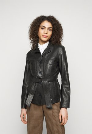 OLLIE - Leather jacket - black