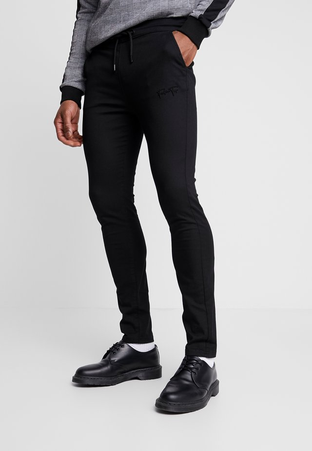 AERO TROUSERS - Bukser - black