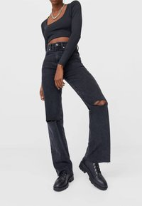 Stradivarius - Straight leg jeans - black - 0