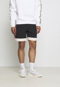 adidas Originals - TAPED UNISEX - Shorts - black - 0
