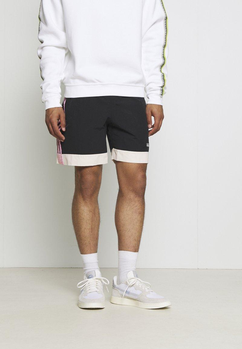 adidas Originals - TAPED UNISEX - Shorts - black