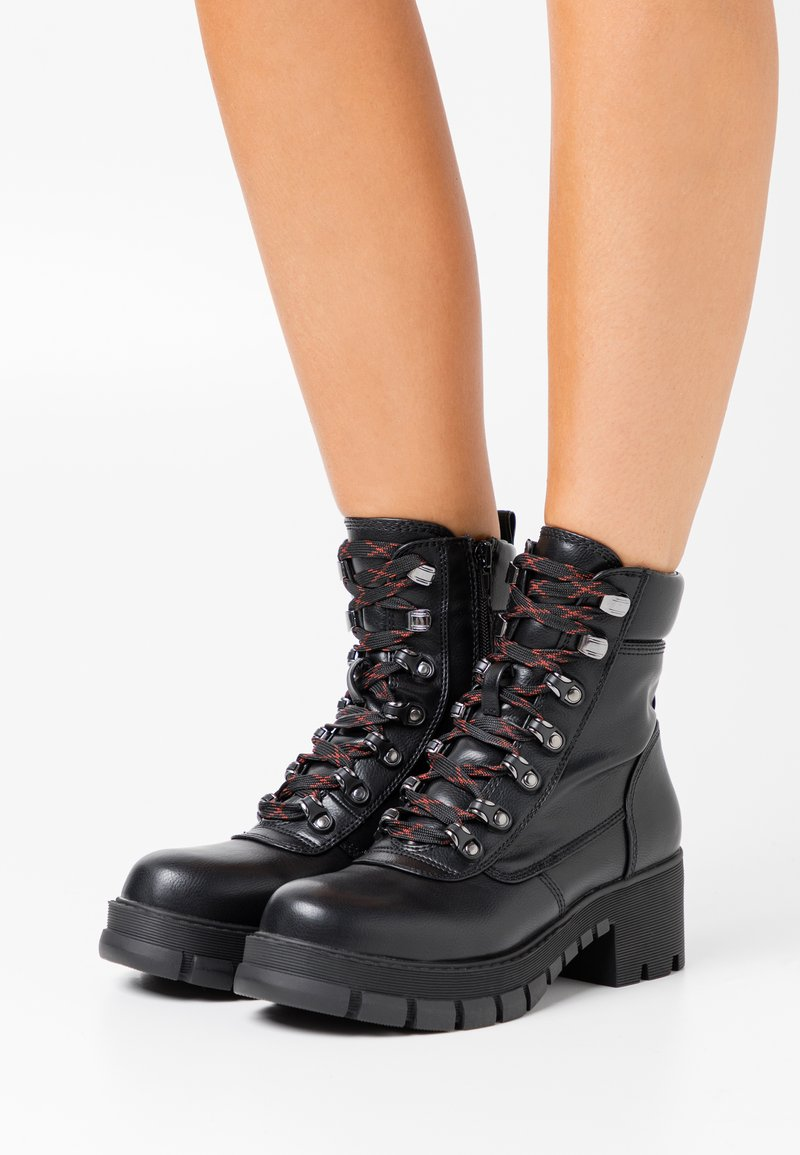 Buffalo - Platform ankle boots - black