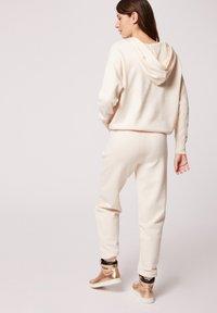 Morgan - HOSEN - Leggings - Trousers - white denim - 2