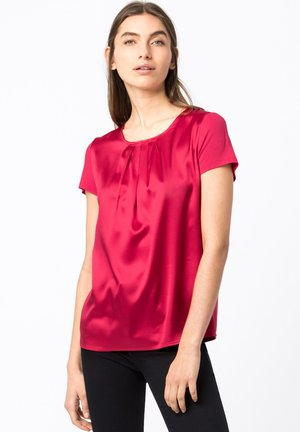 MIT FALTENDETAILS - Blouse - cyclam