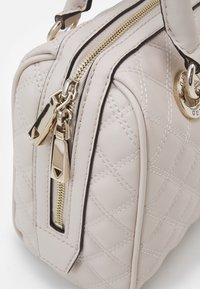 Guess - CESSILY BOX SATCHEL - Handbag - stone - 4