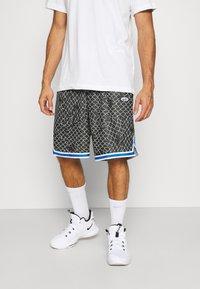 Nike Performance - SEASONAL DNA  - Sports shorts - black/light smoke grey - 0