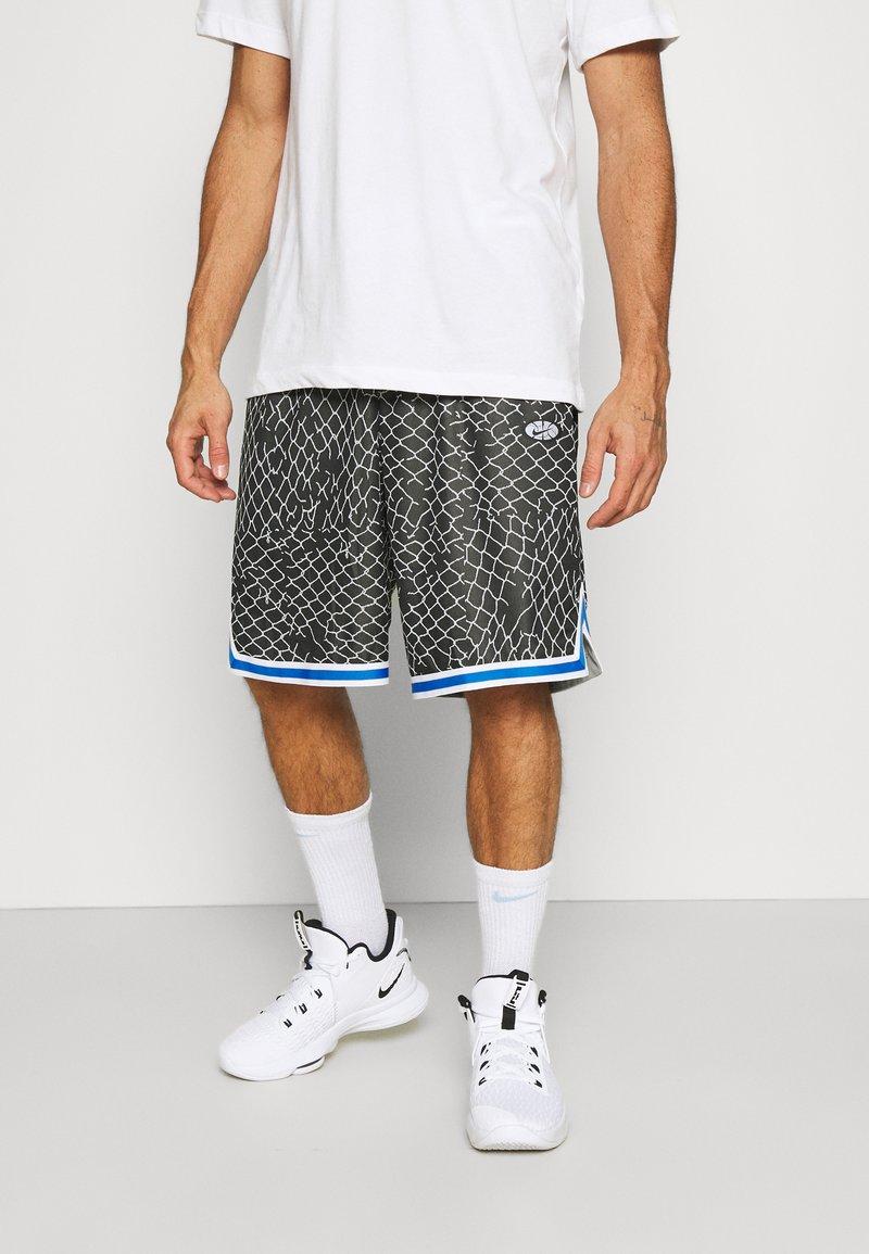 Nike Performance - SEASONAL DNA  - Sports shorts - black/light smoke grey