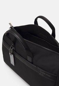 Calvin Klein - UNISEX - Weekend bag - black - 2