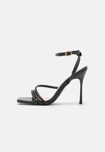 RUPIKA - Sandals - black