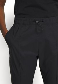 Peak Performance - TECH PANT - Outdoor trousers - black - 3