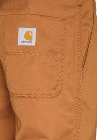 Carhartt WIP - ABBOTT PANT DENISON - Pantalones - rum rinsed - 6