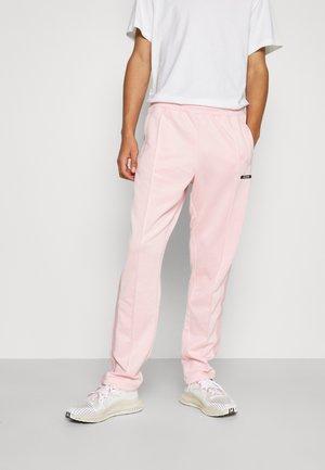 STRIPE TRACK PANT UNISEX - Pantalon de survêtement - pink