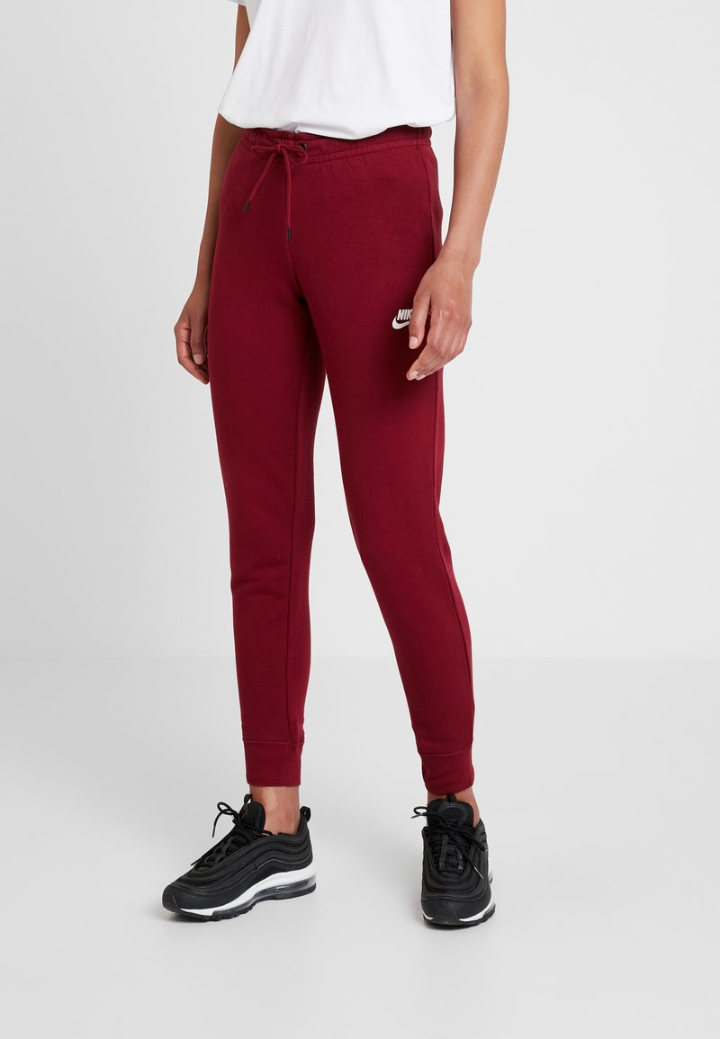 Nike Sportswear - PANT TIGHT - Tracksuit bottoms -  red