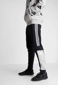 adidas Performance - SPORT ID TAPERED PANT - Træningsbukser - black - 0