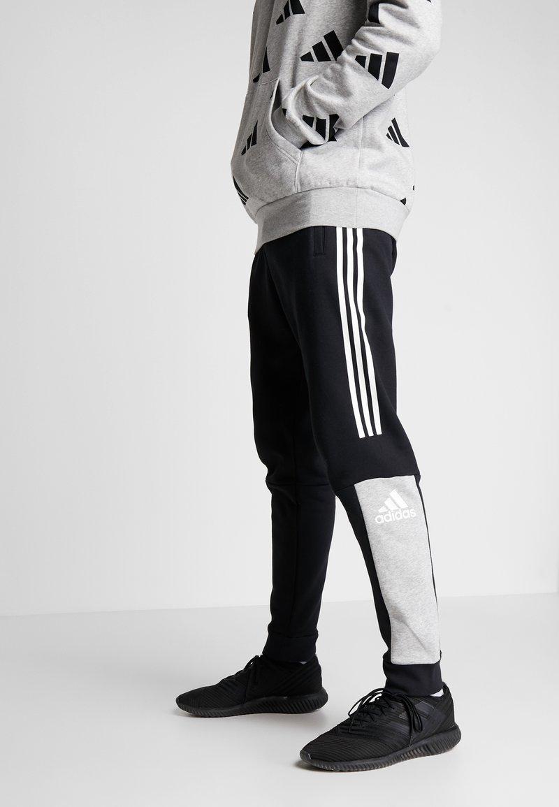 adidas Performance - SPORT ID TAPERED PANT - Træningsbukser - black