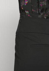 Iro - IMPALA TROUSERS - Kalhoty - black - 5