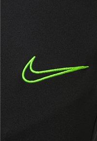 Nike Performance - ACADEMY 21 PANT - Tracksuit bottoms - black/green strike - 4