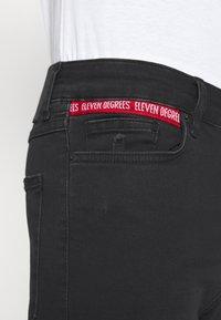 11 DEGREES - ABRASION SUPER SKINNY - Slim fit jeans - black - 5