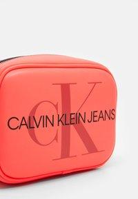 Calvin Klein Jeans - CAMERA BAG - Across body bag - pink - 3
