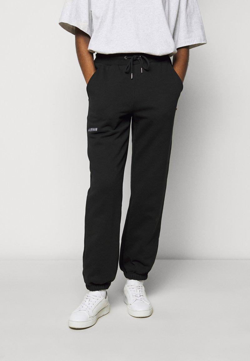 Han Kjøbenhavn - PANTS - Teplákové kalhoty - black