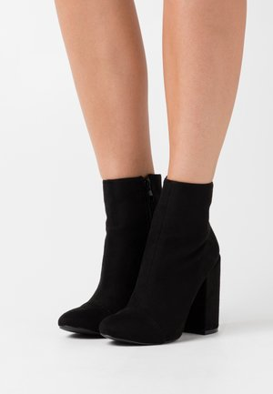 DOLLEY - High heeled ankle boots - black
