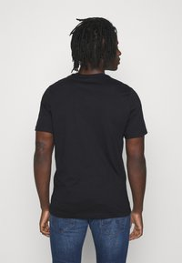 Nike Sportswear - TEE SPRING BREAK - Print T-shirt - black
