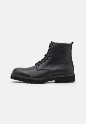 TRUCKER BOOT - Lace-up ankle boots - black