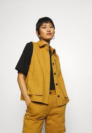 CERRA  - Waistcoat - golden brown