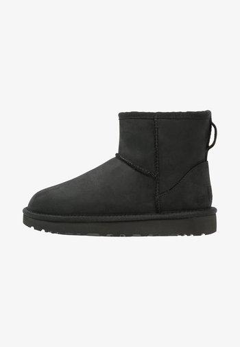CLASSIC MINI - Classic ankle boots - black