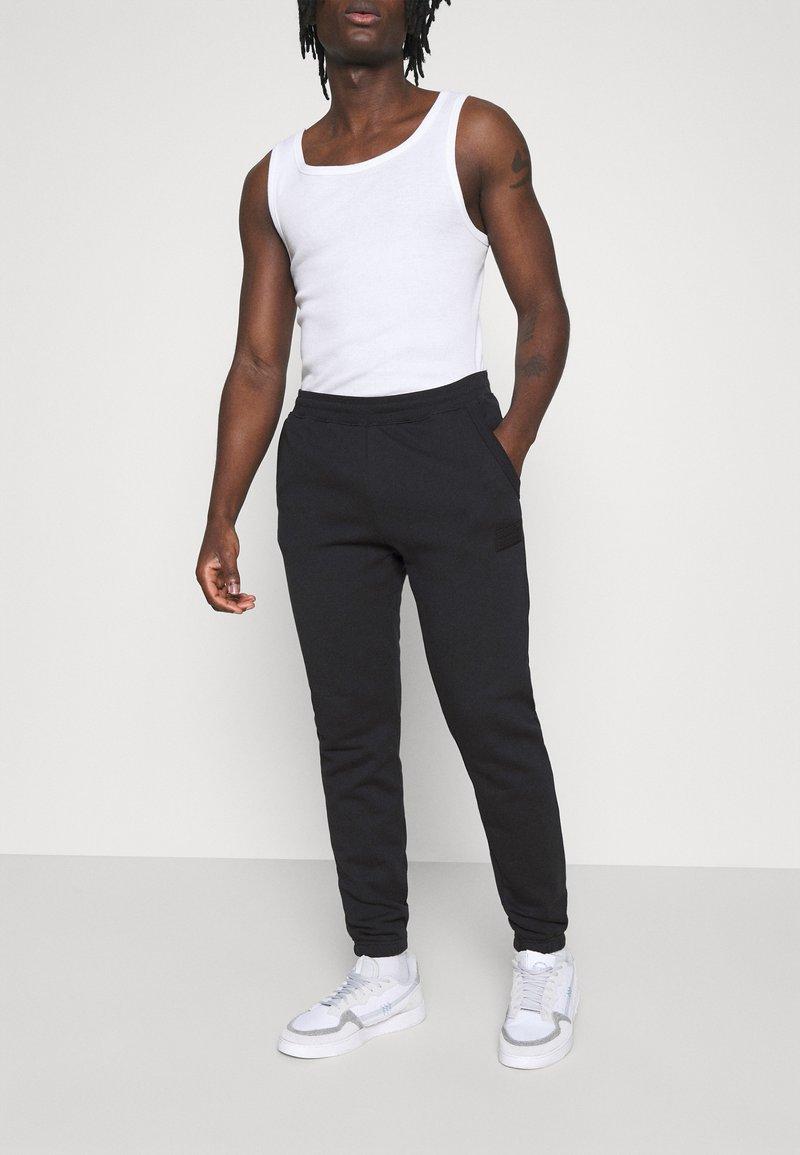 adidas Originals - PANT UNISEX - Tracksuit bottoms - black