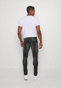 Kings Will Dream - LIMER CARROT - Slim fit jeans - grey/black - 2