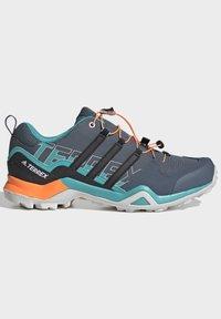 adidas Performance - TERREX SWIFT R2 HIKING SHOES - Hiking shoes - green - 6
