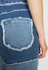 Missguided - FRAY HEM PATCHED - Straight leg jeans - blue - 5