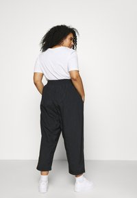 Nike Sportswear - AIR PANT - Tracksuit bottoms - black/white - 2