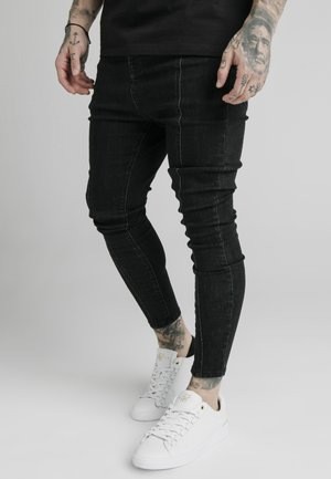 DROP CROTCH PLEATED APPLIQUÉ - Slim fit jeans - black
