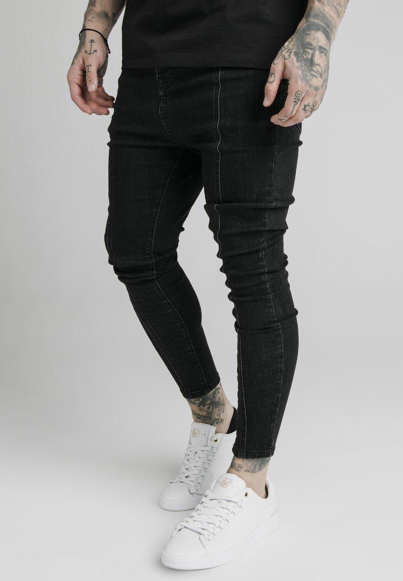 SIKSILK - DROP CROTCH PLEATED APPLIQUÉ - Slim fit jeans - black