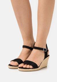 Tamaris - Wedge sandals - black - 0