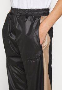 H2O Fagerholt - ALWAYS TRACK PANTS - Tracksuit bottoms - black - 3