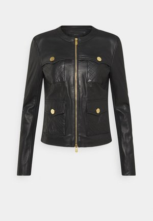 OTTUSO - Leather jacket - black