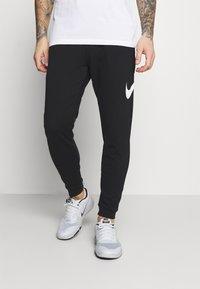 Nike Performance - TAPER - Tracksuit bottoms - black/white - 0