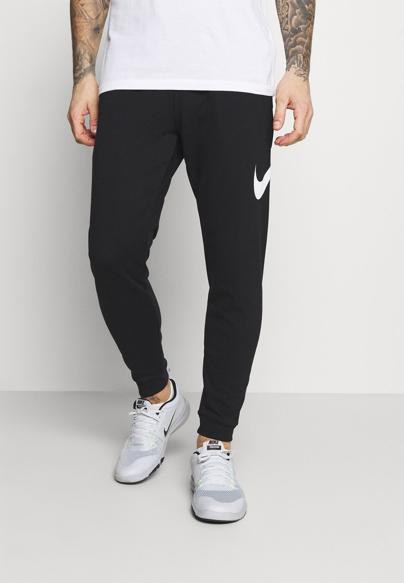 Nike Performance - TAPER - Tracksuit bottoms - black/white